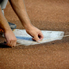 Chalk Line Cord being used to mark lines on baseball field